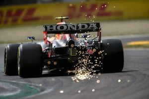 Sparks fly from the rear of Sergio Perez, Red Bull Racing RB16B
