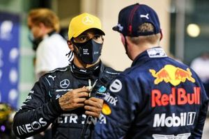 Lewis Hamilton, Mercedes-AMG F1, and pole man Max Verstappen, Red Bull Racing, talk in Parc Ferme
