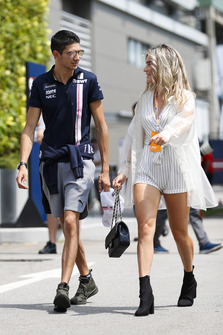 Esteban Ocon, Racing Point Force India, walks in the paddock with a guest