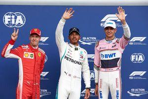 Top three Qualifiers Sebastian Vettel, Ferrari, pole man Lewis Hamilton, Mercedes AMG F1, and Esteban Ocon, Racing Point Force India