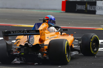 Fernando Alonso, McLaren MCL33, climbs from his heavily damaged car on the opening lap