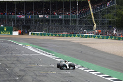 Lewis Hamilton, Mercedes AMG F1 W08, celebrates pole position by waving to the crowd