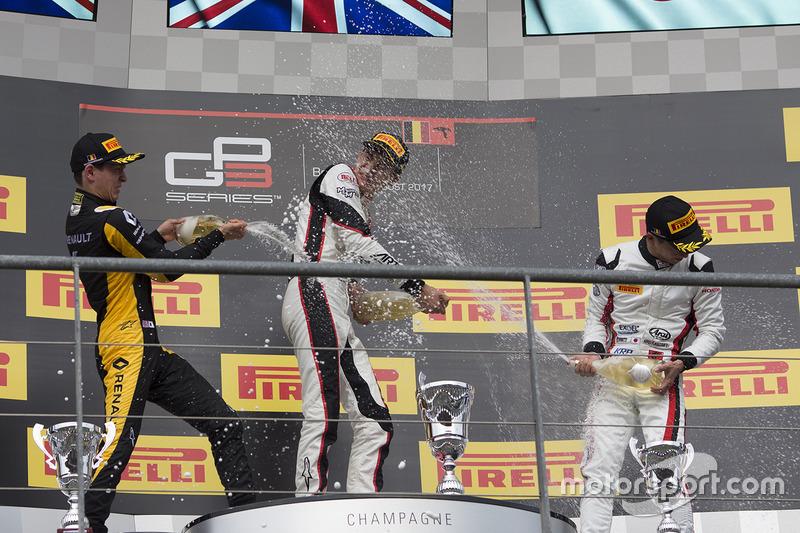 Podium: race winner George Russell, ART Grand Prix, second place Jack Aitken, ART Grand Prix, third