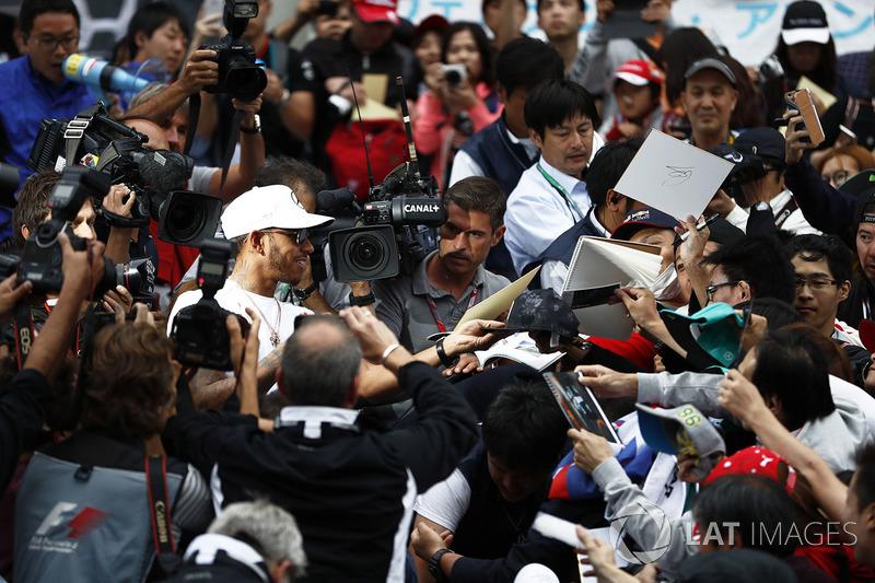 Lewis Hamilton, Mercedes AMG F1, signs autographs for his fans