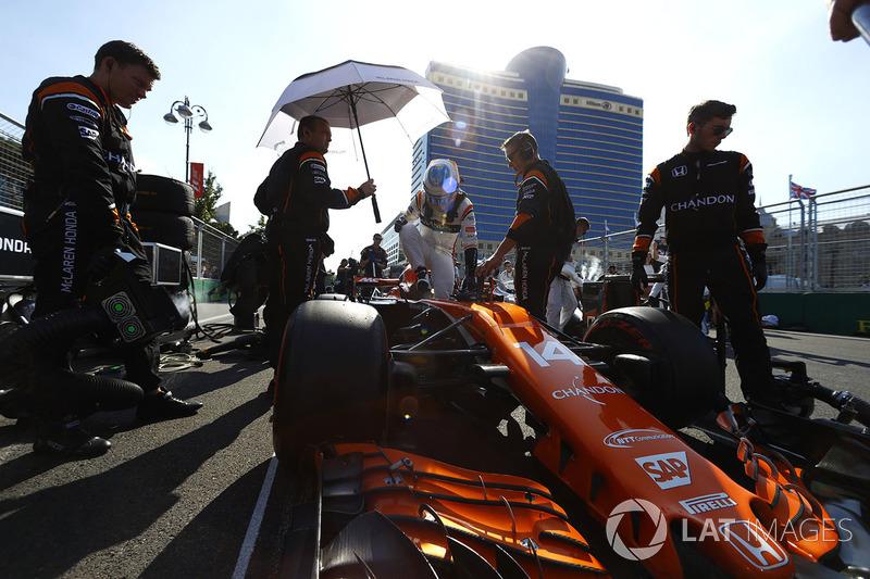 Fernando Alonso, McLaren, exits his car