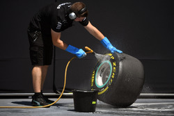 Mercedes AMG F1 mechanic cleans Pirelli tyre