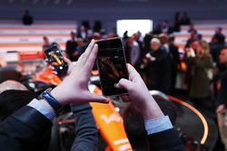Guests take pictures of the McLaren MCL32