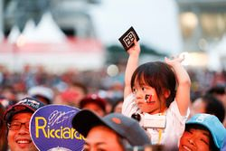 A young fan at the F1 stage in the Fanzone