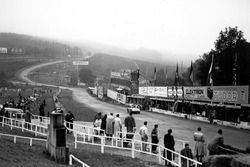 A view looking at the decent down from La Source Hairpin towards Eau Rouge