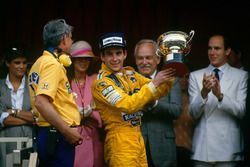 Podium: race winner Ayrton Senna, Team Lotus with Lotus boss Peter Warr, who collected the construct