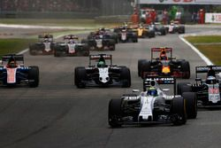Felipe Massa, Williams FW38 Mercedes, leads Fernando Alonso, McLaren MP4-31 Honda; Nico Hulkenberg,