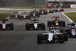 Felipe Massa, Williams FW38 Mercedes, leads Fernando Alonso, McLaren MP4-31 Honda; Nico Hulkenberg,