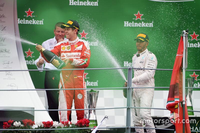 (L to R): Sebastian Vettel, Ferrari celebrates on the podium with Lewis Hamilton, Mercedes AMG F1