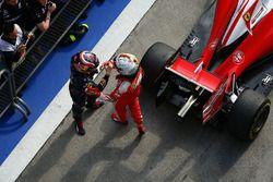 Sebastian Vettel, Ferrari and Daniil Kvyat, Red Bull Racing in parc ferme