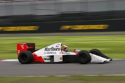 Stoffel Vandoorne,Piloto de prueba y de reserva de McLaren, en el coche de Alain Prost McLaren MP4/5