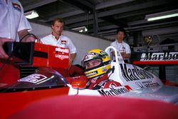 Josef Leberer, McLaren Physio keeps an eye on Ayrton Senna, McLaren as he sits in the cockpit of his