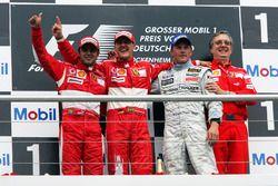 The podium: Felipe Massa, Ferrari, second; Michael Schumacher, Ferrari, race winner; Kimi Raikkonen, McLaren, third; Paolo Martinelli, Ferrari Engine Director