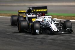 Marcus Ericsson, Sauber C37, leads Nico Hulkenberg, Renault Sport F1 Team R.S. 18