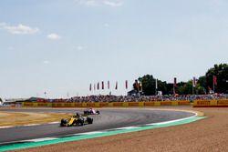 Nico Hulkenberg, Renault Sport F1 Team R.S. 18, leads Esteban Ocon, Force India VJM11