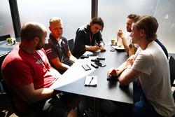 Kevin Magnussen, Haas F1 Team, talks to the media