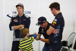 Max Verstappen, Red Bull Racing, signs an autograph for a young fan, as Brendon Hartley, Scuderia Toro Rosso, looks on