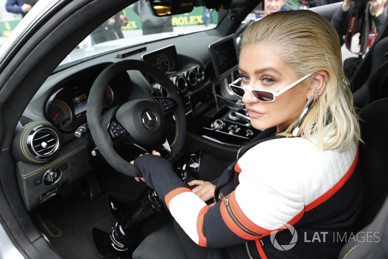 Singer Christina Aguilera sits in the Safety Car