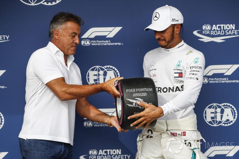 Jean Alesi presents Lewis Hamilton, Mercedes AMG F1, with the Pirelli Pole Position award