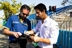 Lucas di Grassi, Audi Sport ABT Schaeffler, gives feedback on track condition to Michelin engineer