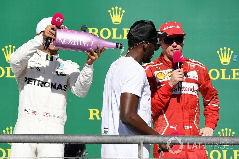 Race winner Lewis Hamilton, Mercedes AMG F1 celebrates on the podium with the champagne and Usain Bolt, Kimi Raikkonen, Ferrari