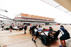Felipe Massa, Williams FW40, Lance Stroll, Williams FW40, are returned to the Williams garage