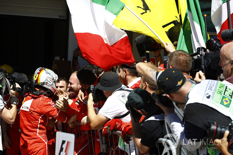 Sebastian Vettel, Ferrari SF70H, celebrates with his team after winning the race
