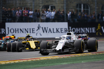 Lance Stroll, Williams FW41, leads Carlos Sainz Jr., Renault Sport F1 Team R.S. 18, and Valtteri Bottas, Mercedes AMG F1 W09