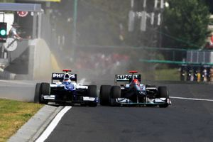 Michael Schumacher, Mercedes GP MGP W01 squeezes Rubens Barrichello, Williams FW32