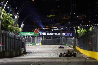 Romain Grosjean, Haas F1 Team VF-18, leads Pierre Gasly, Scuderia Toro Rosso STR13
