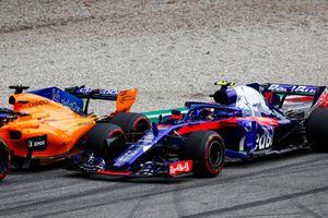 Fernando Alonso, McLaren MCL33, and Pierre Gasly, Toro Rosso STR13, go wheel-to-wheel