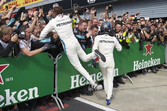 Lewis Hamilton, Mercedes AMG F1, and Valtteri Bottas, Mercedes AMG F1, celebrate in parc ferme