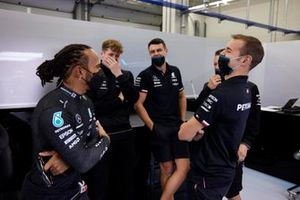 Lewis Hamilton, Mercedes, talks with members of his team