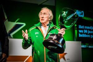 Sir Jackie Stewart holding the Dutch GP trophy