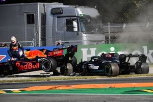Max Verstappen, Red Bull Racing, climbs out of his car after colliding with Lewis Hamilton, Mercedes W12