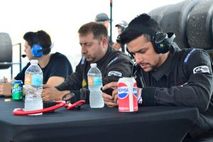 Crew members watch data and telemetry on the #19 MP1B Porsche 991 driven by Lino Fayen & Angel Benitez Jr. of Formula Motorsport
