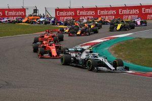 Valtteri Bottas, Mercedes AMG W10, leads Charles Leclerc, Ferrari SF90, Sebastian Vettel, Ferrari SF90, Max Verstappen, Red Bull Racing RB15, Pierre Gasly, Red Bull Racing RB15, and the remainder of the field at the start