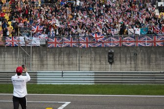 Race winner Lewis Hamilton, Mercedes AMG F1, takes a photo of his supporters