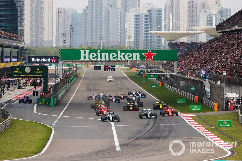 Lewis Hamilton, Mercedes AMG F1 W10, leads Valtteri Bottas, Mercedes AMG W10, Charles Leclerc, Ferrari SF90, Sebastian Vettel, Ferrari SF90, Max Verstappen, Red Bull Racing RB15, and the rest of the field towards the first corner
