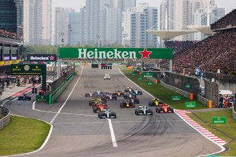 Lewis Hamilton, Mercedes AMG F1 W10, leads Valtteri Bottas, Mercedes AMG W10, Charles Leclerc, Ferrari SF90, Sebastian Vettel, Ferrari SF90, Max Verstappen, Red Bull Racing RB15, and the rest of the field towards the first corner