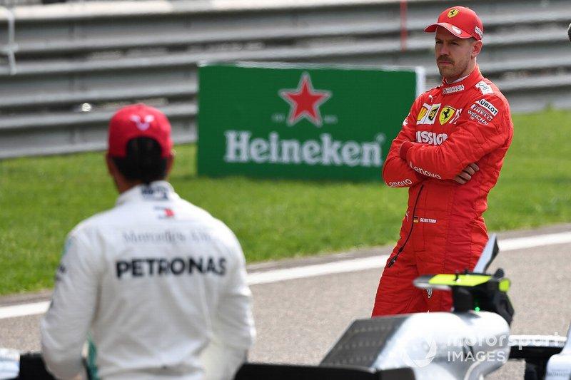 Lewis Hamilton, Mercedes AMG F1, and Sebastian Vettel, Ferrari, n the grid