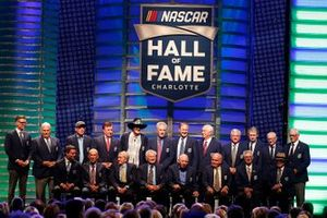 Members of the NASCAR Hall of Fame stand on stage