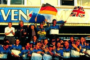 Michael Schumacher celebrates with Flavio Briatore, Luciano Benetton and rest of the Benetton Renault team after winning the World Drivers Championship and the Constructors Championship