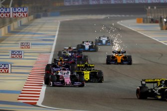 Daniel Ricciardo, Renault R.S.19, leads Sergio Perez, Racing Point RP19, Nico Hulkenberg, Renault R.S. 19, and Pierre Gasly, Red Bull Racing RB15, as sparks fly from Lando Norris, McLaren MCL34