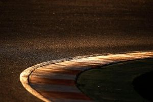 Sunset reflects on track and kerb