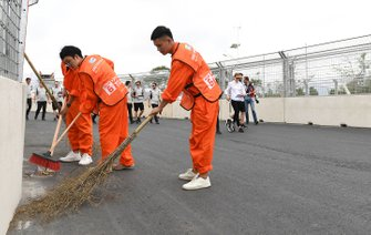 Track workers clean the circuit